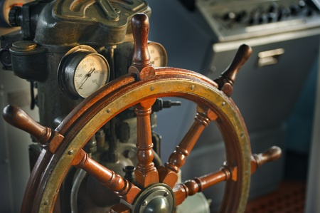 wood steering wheel in big ship