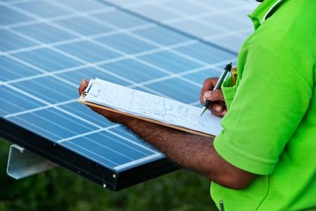 engineer checking solar power station  photo