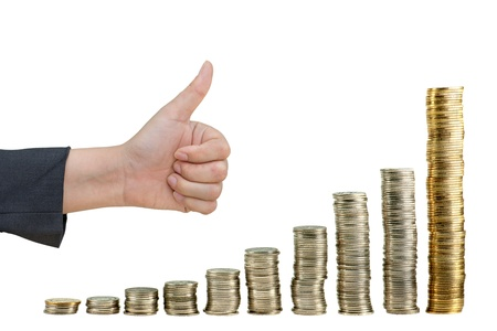 Hand showing good in graph  from coin Stock Photo - 11957067