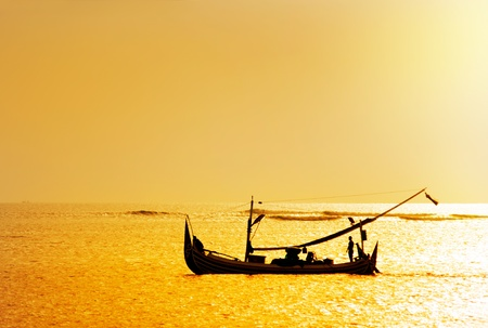 local boat on the beach at sunset time . Bali , Indonesia photo