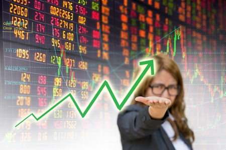 business woman open hand showing graph in stock exchange board  photo