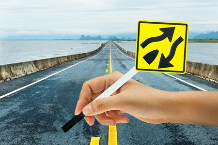 safe water: Traffic sign  Dual Carriage Way End  in Long road  Stock Photo