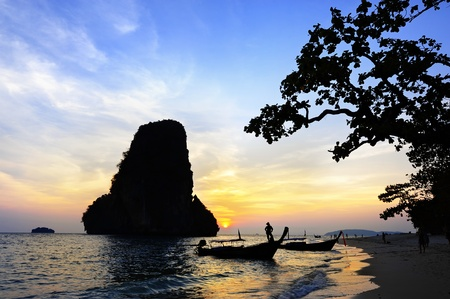silhouette of island and beach in twilight photo