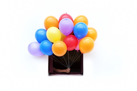 hand holding color balloons  from window Stock Photo - 12782998