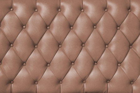 plain button: background image of plush beown leather  Stock Photo