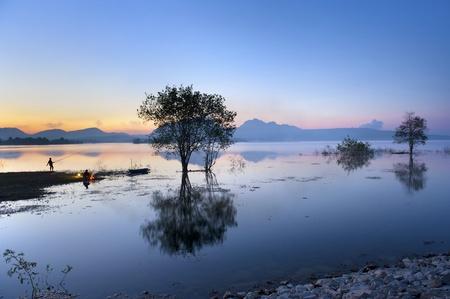 fisherman camping in big lake Stock Photo - 12783119