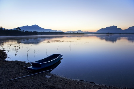 silence lake and boat in morning  photo