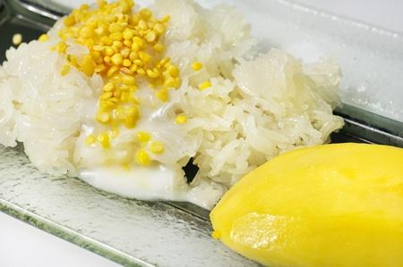 Sticky Rice and Mango wirh coconut milk is Thai Dessert photo