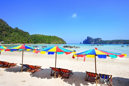 many color umbrellas on the beach at Phuket , thailand
