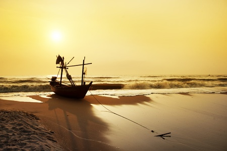 Old Fisherman boat at sunrise photo