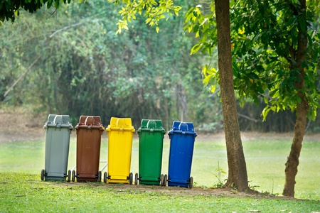 five colors recycle bins in  forest
