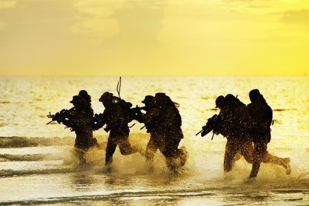 Soldiers run in army uniform Stock Photo