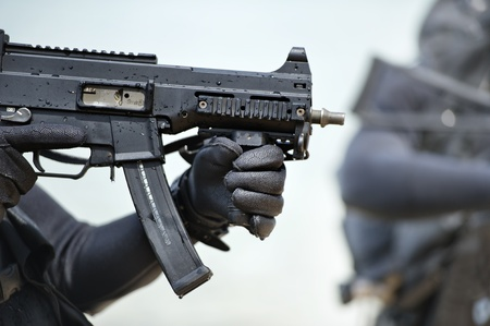 Navy seals carry gun from sea Stock Photo