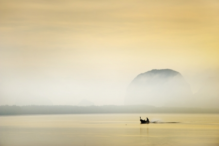 fisherman on boat in morning ,thailand photo