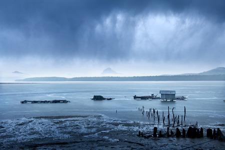 heavy: Fisherman  in heavy rain