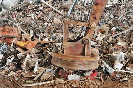 corroding: Big machine magnet in junk yard