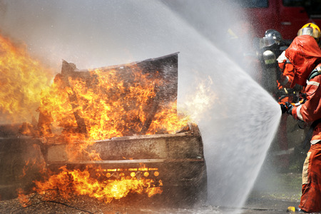 burning: Firefighters fighting fire during training