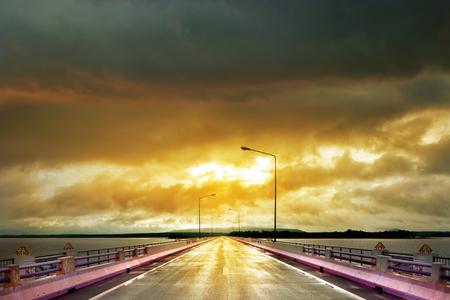 long lake: Long road through big lake in morning