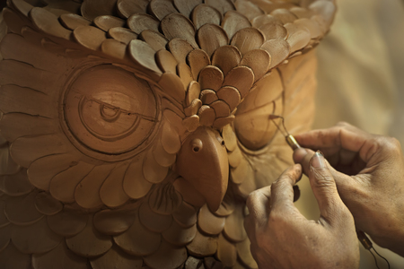 sculpture: Owl made by browm clay