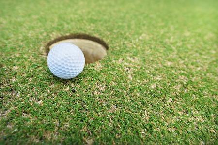 hole: golf ball on hole Stock Photo
