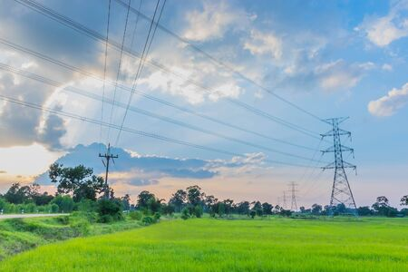 The high voltage tower, electric wire pole pattern, the beautiful blue sky, and the cloud in Thailand.