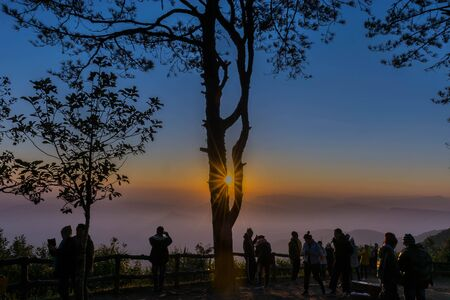The silhouette of tourists watching the sea mists at the top of the mountain, Phurua district, Loei province, Thailand.
