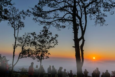 The silhouette of tourists watching the sea mists at the top of the mountain, Phurua district, Loei province, Thailand. Standard-Bild - 138039715
