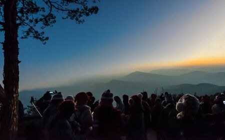 The silhouette of tourists watching the sea mists at the top of the mountain, Phurua district, Loei province, Thailand. Standard-Bild - 138039717