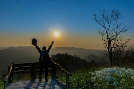 Silhouette sunrise the viewpoint at the mountain in the Phu Pa por at Loei province, Thailand fuji mountain. Standard-Bild - 138039740