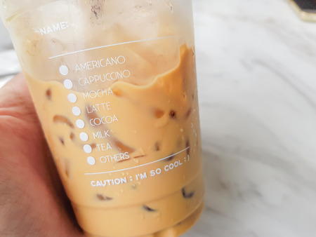 Iced Coffee In Plastic Glass With Check List Of Coffee Type Place On Hand