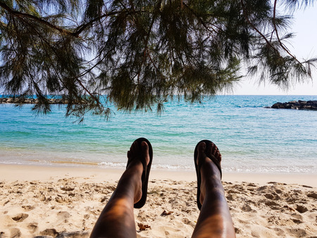 Asian Women Feet on The Background Of Sea, Sand, Rock, Sky And Trees. Concept Happy Life, Holiday, Traveller, Relax