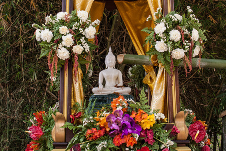 lent: Buddha image and flowers in the annual Buddhist lent songkran festival