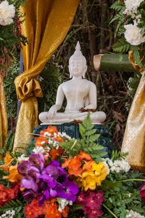 auspiciousness: Buddha image and flowers