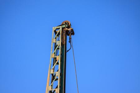 Lack of crane hook, construction crane and blue sky. Constructiona and building equipment