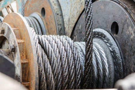 Industrial background with a coiled steel cable Stock Photo