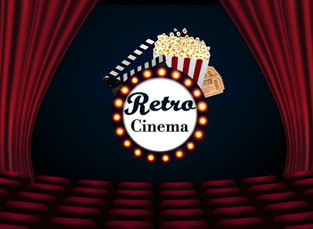 Movie theater with row of red seats popcorn and tickets.