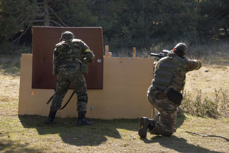 airsoft: Couple of Airsoft soldiers shooting in an Airsoft party