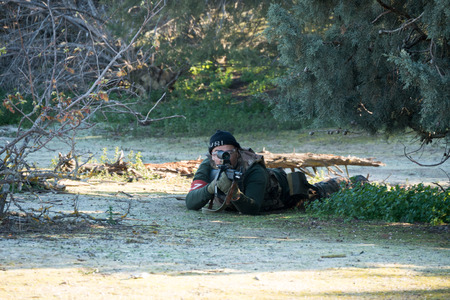 sniper training: Airsoft soldier shooting in an Airsoft party