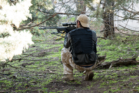sniper training: Airsoft sniper shooting in an Airsoft party Stock Photo