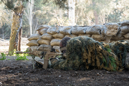 sniper training: Airsoft soldier waiting  in an Airsoft party