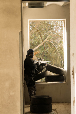 airsoft: Airsoft soldier waiting  in an Airsoft party