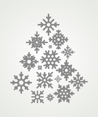 the snowflake: snowflakes set  in the form of a Christmas tree. Snowflakes icons on gray background.