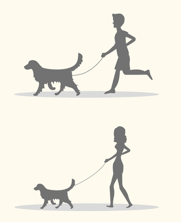 dog walking: Silhouettes of men and women walking the dogs.