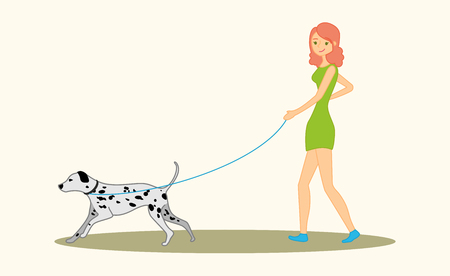 Women walking the dog dalmatian breed.
