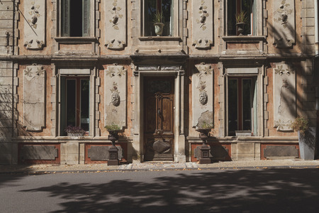 Old Retro Renaissance Facade with Cracked Plaster, France photo