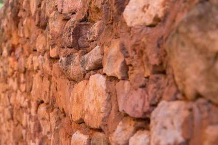 ochre: Red Ochre Stone Wall Detail Stock Photo