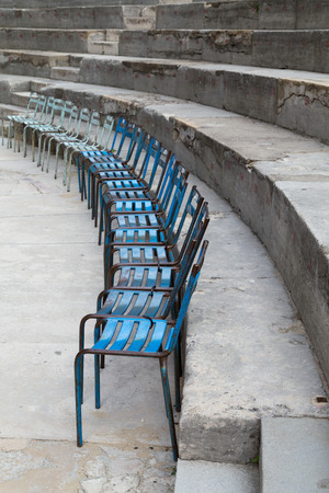 theatrics: Old Metal Chairs at Ancient Theater of Orange, France Stock Photo