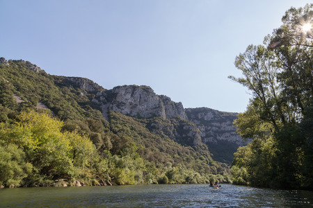 cayak: Canoeing and Kayaking on River Canyon Stock Photo