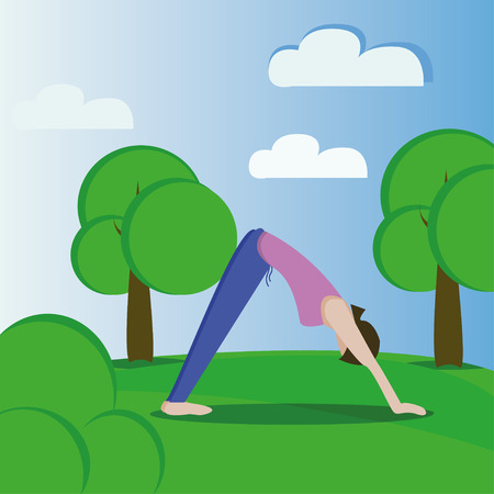 The girl practices yoga in the park