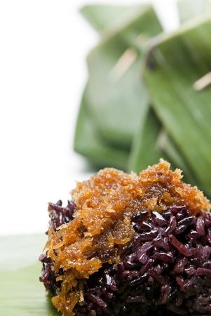 selenium: black sticky rice with caramelised coconut on white background Stock Photo